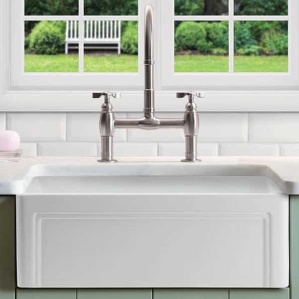 A fireclay or ceramic apron-front farmhouse sink using a gooseneck faucet functions in almost any vintage-style kitchen, but it is more at home in older houses and farmhouses instead of in midcentury ranches.